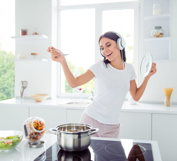 woman dancing while cooking