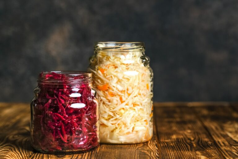 Fermented,Foods.,Sauerkraut,And,Red,Cabbage,On,A,Rustic,Background